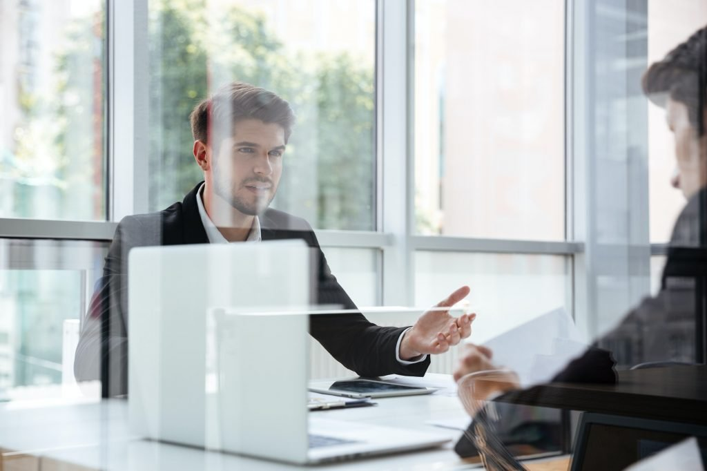 Two businessmen with laptop on business meeting